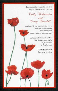 a red and black layered wedding invitation with poppy plowers