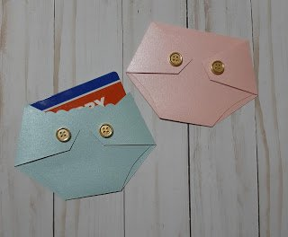 pink and blue prince and princess diaper shaped gift card holder for baby shower game prizes