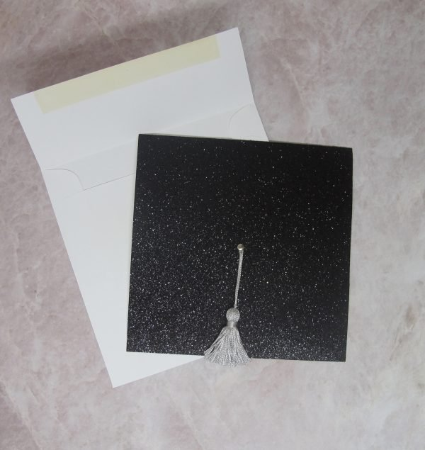 black glitter graduation invitation with white envelope