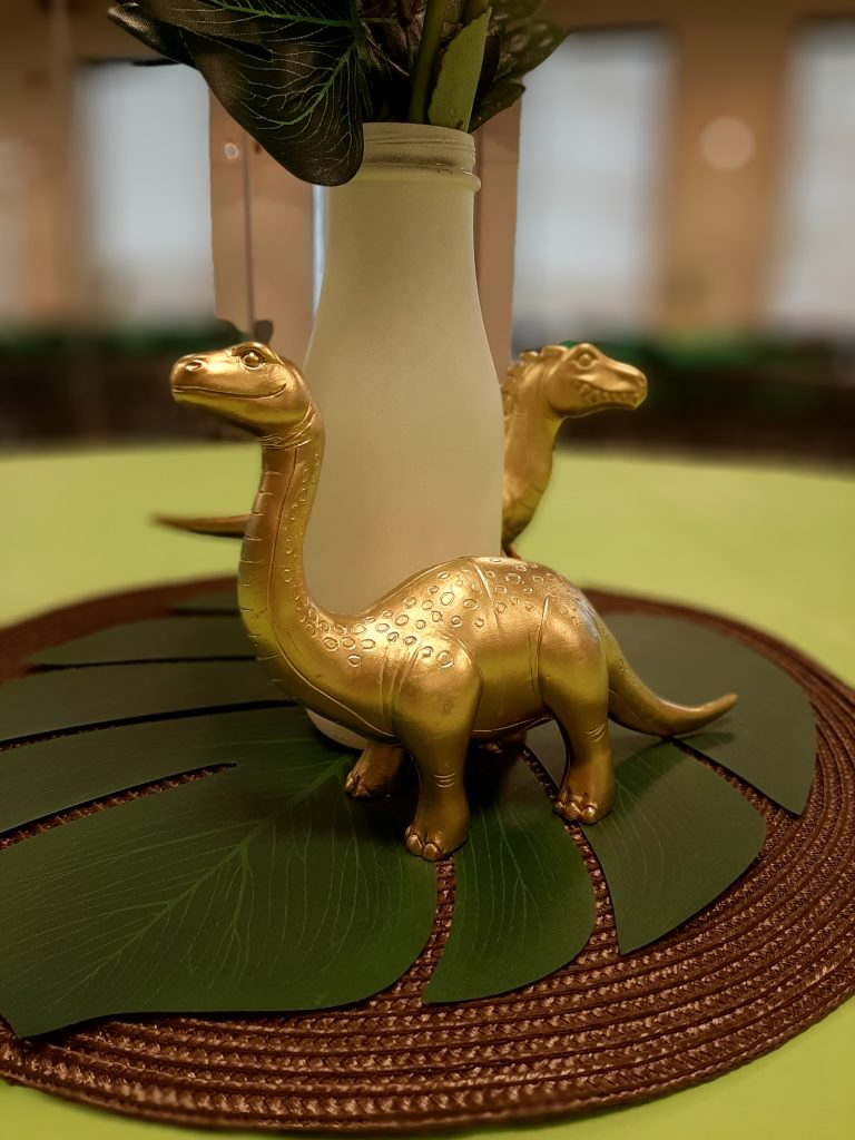 gold dinosaur centerpieces at baby shower